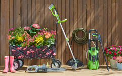 a weeder, wagon, power washer and other lawn equipment