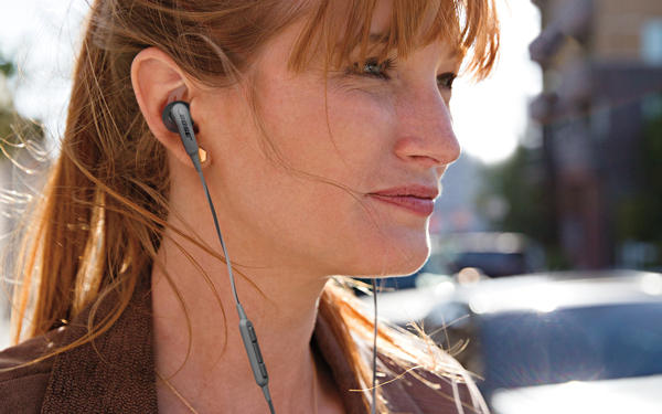 a woman wearing ear buds