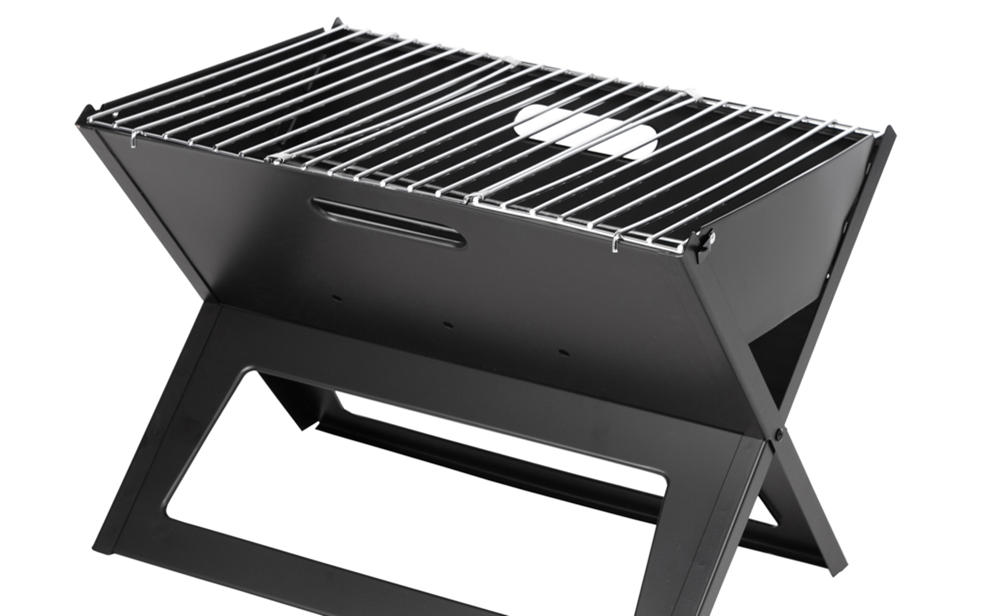 a charcoal grill that is sadly without any delicious food cooking atop it.