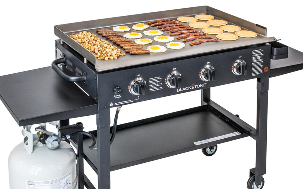 a gas grill. there's some burgers on this one.