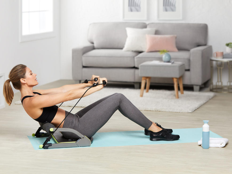 a woman working out with a resistance band seat